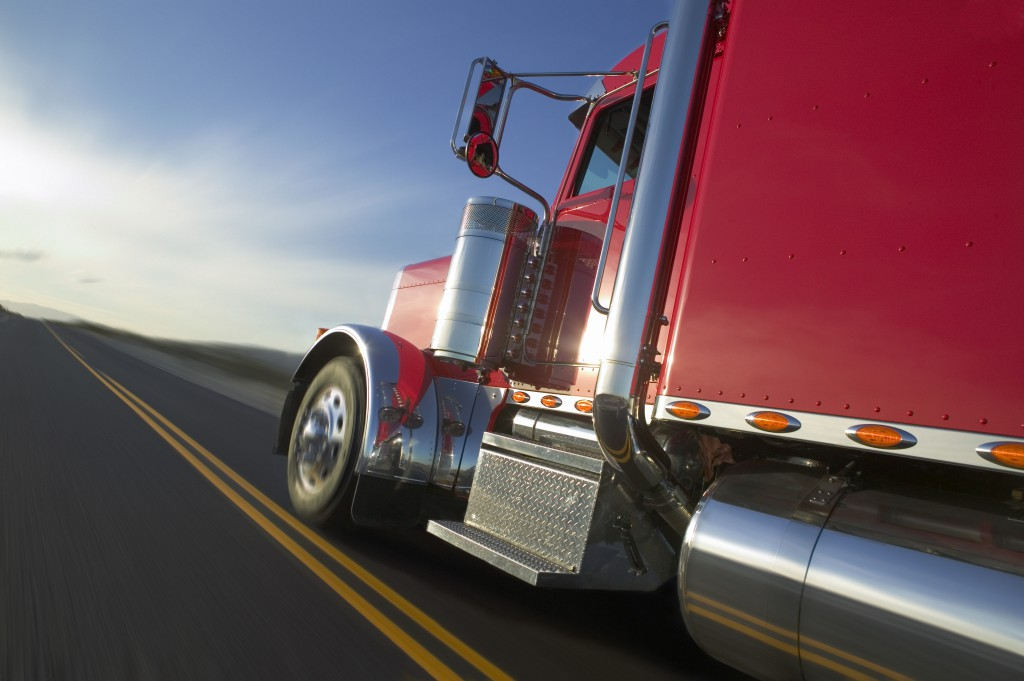 Truckdriver on Highway --- Image by © Royalty-Free/Corbis