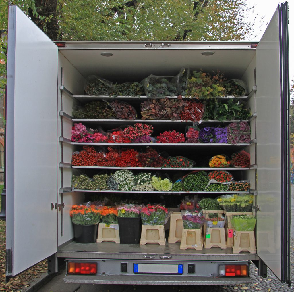 lorry body with bunches of flowers, Milan